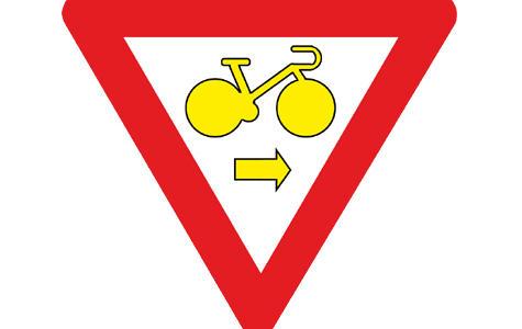 Bicicliștii belgieni vor putea trece pe roșu legal